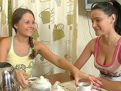 Two lesbian teens having fun together