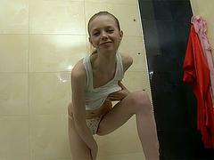 wet teen girl posing in bathroom